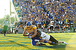 BROOKINGS, SD - SEPTEMBER 20:  Jason Schneider #83 from South Dakota State hauls in a touchdown pass while being brought down by Anthony Fassett #25 from Wisconsin-Oshkosh in the first half of their game Saturday at Coughlin Alumni Stadium in Brookings. (Photo/Dave Eggen/Inertia)