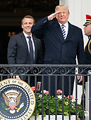United States President Donald J. Trump, right, salutes as President Emmanuel Macron of France, left, looks on following an arrival ceremony on the South Lawn of the White House in Washington, DC on Tuesday, April 24, 2018.<br /> Credit: Ron Sachs / CNP