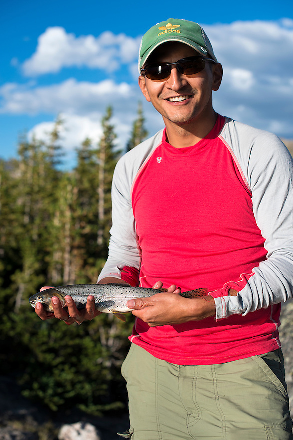 An angler displays a Yellowstone cutthroat trout in the Absaroka-Beartooth Wilderness.