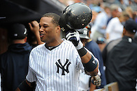 New York Yankees second baseman Robinson Cano #24is greeted by team mates after hitting his third grand slam home run of the year against the Baltimore Orioles pitcher Chris Jakubauskas (not shown) during the 2nd inning at Yankee Stadium on September 5, 2011 in Bronx, NY.  Yankees defeated Orioles 11-10.  Tomasso DeRosa/Four Seam Images