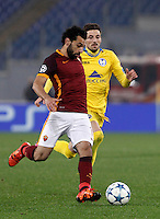 Calcio, Champions League: Gruppo E - Roma vs Bate Borisov. Roma, stadio Olimpico, 9 dicembre 2015.<br /> Roma's Mohamed Salah, left, is chased by Bate Borisov's Filip Mladenovic during the Champions League Group E football match between Roma and Bate Borisov at Rome's Olympic stadium, 9 December 2015.<br /> UPDATE IMAGES PRESS/Isabella Bonotto