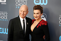 Patrick Stewart and singer Sunny Ozell attend the 23rd Annual Critics' Choice Awards at Barker Hangar in Santa Monica, Los Angeles, USA, on 11 January 2018. Photo: Hubert Boesl - NO WIRE SERVICE - Photo: Hubert Boesl/dpa /MediaPunch ***FOR USA ONLY***