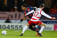 Tyrell Robinson of Bradford City and Matty Blair of Doncaster Rovers during the Sky Bet League 1 match between Doncaster Rovers and Bradford City at the Keepmoat Stadium, Doncaster, England on 19 March 2018. Photo by Thomas Gadd.