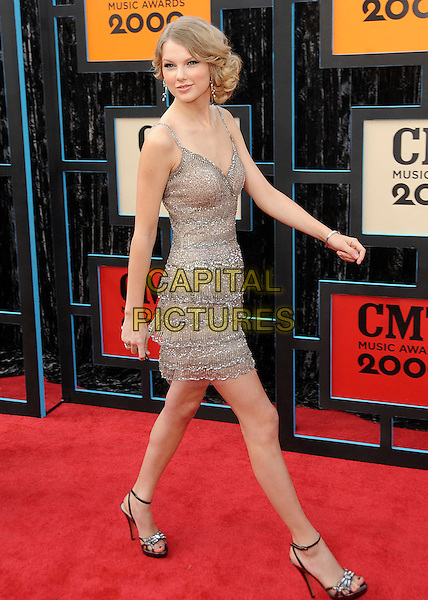 TAYLOR SWIFT.2009 CMT Music Awards held at the Sommet Center, Nashville, TN, USA..June 16th, 2009.full length silver gold dress layered layers walking beads beaded .CAP/ADM/MS.©Mike Strasinger/AdMedia/Capital Pictures.