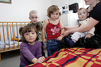 Chechen woman with her 4 children (2 sons of 1- and 2-years old and 2 daughter of 3- and 4-years old) in the URiC Wolomin Refugee Centre. .Her husband use to fight during the 2nd war in Chechnya. Over 1 year ago they've immigrated to Poland and then to Belgium. Theirs youngest son was born there and received the Belgium citizenship. Despite that after 5 month the family was brought back to Poland and awaiting the granting of the Status of Refugee here..-For security reason, the face of the adult asylum seeker have been evicted of the photography..-For security reason, the names of the adult asylum seeker have been change. .-Article 9 of the Act of 13 June 2003 on grating protection on the Polish territory (Journal of Laws, No 128, it. 1176) personal data of refugees are an object of particular protection..-Cases where publication of a picture or name of asylum seeker had dramatic consequences for this persons and is family back in Chechnya. .Please have safety of those people in mind. Thank you.