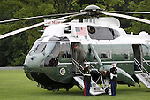 United States President Barack Obama steps onto Marine One to return to the White House after attending two campaign events at a private residence in McLean, Virginia on April 27, 2012.  .Credit: Molly Riley / Pool via CNP