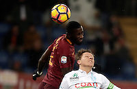 Calcio, Serie A: Roma vs ChievoVerona. Roma, stadio Olimpico, 22 settembre 2016.<br /> Roma's Antonio Rudiger, left, and Chievo Verona's Nicolas Frey jump for the ball during the Italian Serie A football match between Roma and Chievo Verona, at Rome's Olympic stadium, 22 December 2016.<br /> UPDATE IMAGES PRESS/Isabella Bonotto