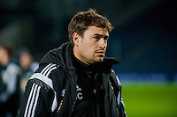 WEST BROMWICH, ENGLAND - FEBRUARY 11:  Swansea assistant manager Josep Clotet walks on the pitch prior to the Premier League match between West Bromwich Albion and Swansea City at The Hawthorns on February 11, 2015 in West Bromwich, England. (Photo by Athena Pictures/Getty Images)