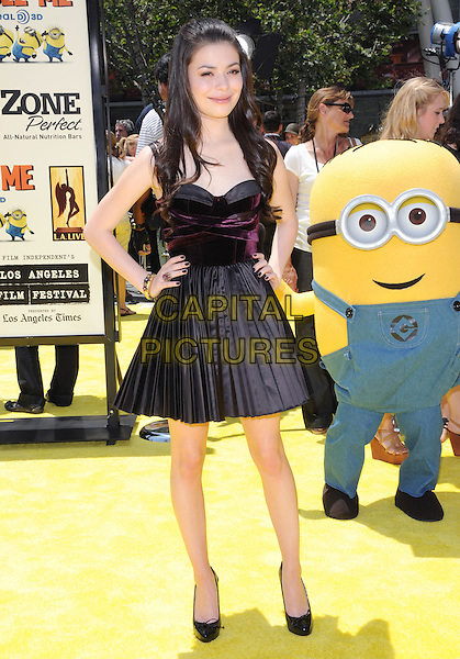 "MIRANDA COSGROVE .at the Universal Pictures' World Premiere of ""Despicable Me"" held during the Los Angeles Film Festival at Nokia Live in Los Angeles, California, USA, .June 27th 2010..full length dress sleeveless black pleated patent shoes  hands on hips                                          .CAP/RKE/DVS.©DVS/RockinExposures/Capital Pictures."