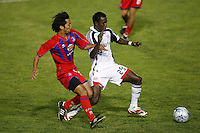 """Crystal Palace defender Shintaro Harada (21) and New England Revolution forward Abdoulie """"Kenny"""" Mansally (29). The New England Revolution (MLS) defeated Crystal Palace FC USA of Baltimore (USL2) 5-3 in penalty kicks after finishing regulation and overtime tied at 1-1 during a Lamar Hunt US Open Cup quarterfinal match at Veterans Stadium in New Britain, CT, on July 8, 2008."""