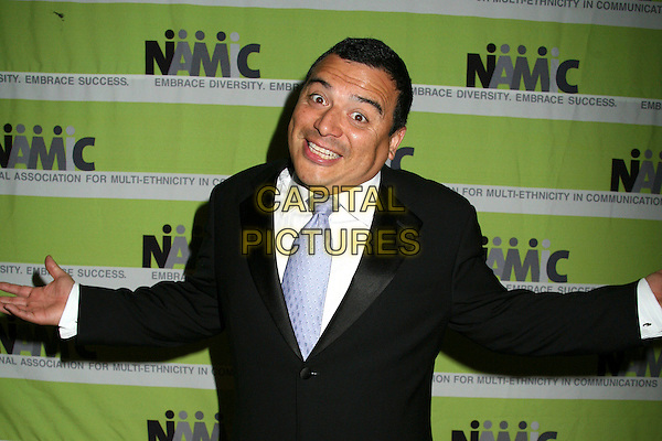 CARLOS MENCIA.12th Annual NAMIC Vision Awards, Beverly Hills, California, USA..April 18th, 2006.Photo: Byron Purvis/AdMedia/Capital Pictures.Ref: BP/ADM.half length funny face arms.www.capitalpictures.com.sales@capitalpictures.com.© Capital Pictures.