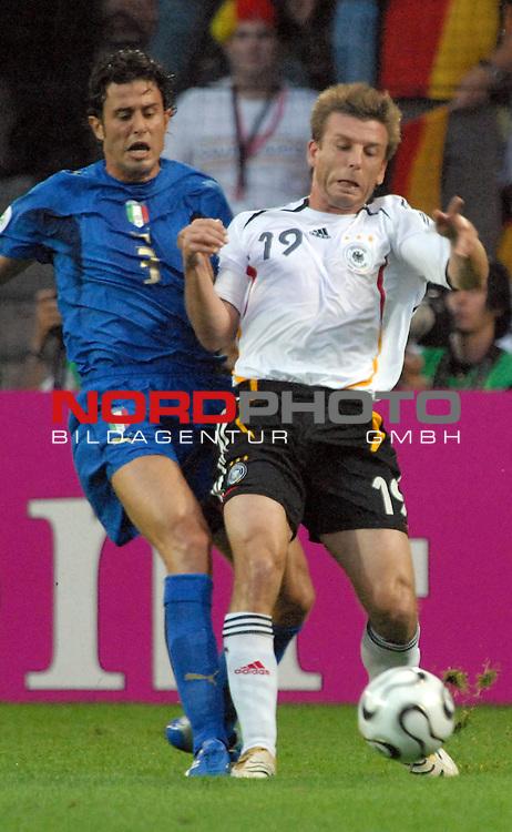 FIFA WM 2006 -  Semi Finals / Halbfinale<br /> <br /> Play    #61 (04-Juli) - Deutschland - Italien<br /> <br /> <br /> <br /> Bernd Schneider (GER) gegen Fabio Grosso (ITA)<br /> <br /> <br /> <br /> Foto &copy; nordphoto