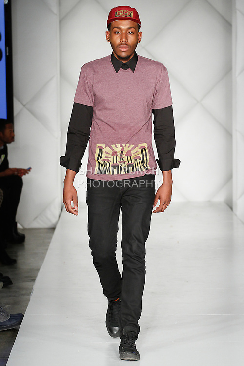 Model walks runway in an outfit from the BuddhaHood collection by Dario Mohr, during Fashion Week Brooklyn Fall Winter 2014, Day 1 at Industry City, on March 13, 2014.