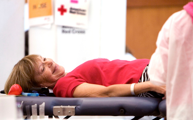 SOUTHBURY CT. 16 June 2014-061614SV03-Janet Hertzmark of Oxford gives blood during a blood drive at the Jewish Federation of Western Connecticut in Southbury Monday. <br /> Steven Valenti Republican-American