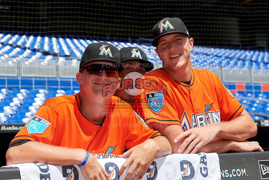 Miami Marlins pitcher Braxton Garrett (25), pitcher Jordan Holloway (31) and pitcher Trevor Rogers (38) in the dugout before a Florida Instructional League game against the Washington Nationals on September 26, 2018 at the Marlins Park in Miami, Florida.  (Mike Janes/Four Seam Images)