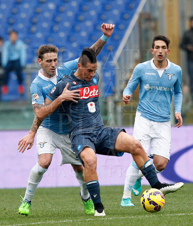 Calcio, Serie A: Lazio vs Napoli. Roma, stadio Olimpico, 18 gennaio 2015.<br /> Napoli&rsquo;s Marek Hamsik, center, is challenged by Lazio&rsquo;s Lucas Biglia, left, during the Italian Serie A football match between Lazio and Napoli at Rome's Olympic stadium, 18 January 2015.<br /> UPDATE IMAGES PRESS/Riccardo De Luca