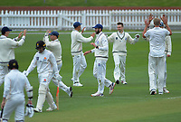 Auckland players celebrate the dismissal of Tom Blundell during day one of the Plunket Shield cricket match between the Wellington Firebirds and Auckland at Basin Reserve in Wellington, New Zealand on Friday, 8 November 2019. Photo: Dave Lintott / lintottphoto.co.nz