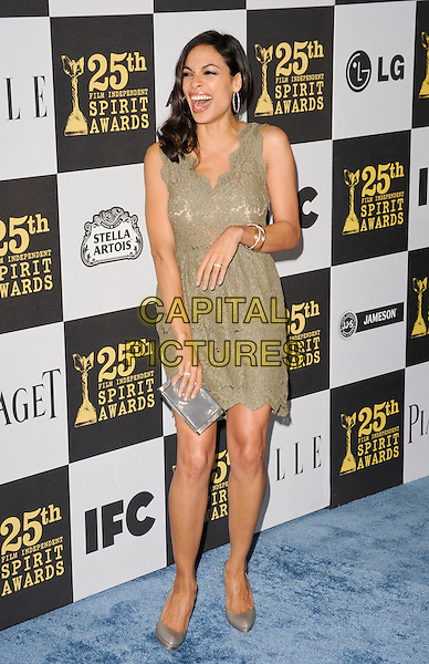 ROSARIO DAWSON.The 25th Annual Film Independent Spirit Awards at the LA Live Event Deck in Los Angeles, California, USA..March 5th, 2010  .full length green dress lace sleeveless hand   clutch bag smiling grey gray shoes mouth open laughing .CAP/ROT.©Lee Roth/Capital Pictures