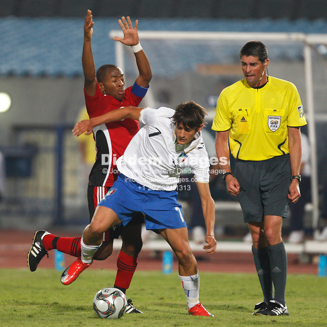CAIRO, EGYPT - SEPTEMBER 28:  Leston Paul of Trinidad and Tobago (l) defends against Claudio Della Penna of Italy (r) during a FIFA U-20 World Cup soccer match September 28, 2009 in Cairo, Egypt.  (Photograph by Jonathan P. Larsen)
