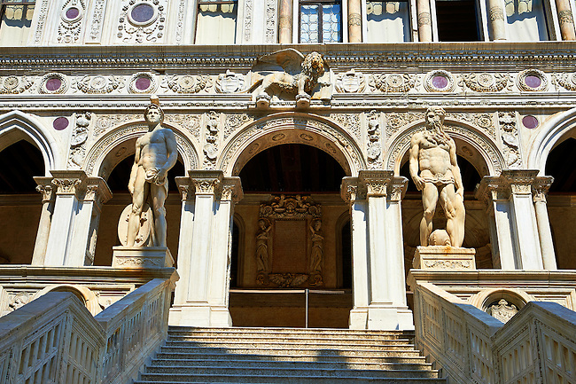The 1485 ceremonial staircase built within the courtyard of the Doge's Palace  known as the Giants' Staircase which is  guarded by Sansovino's two colossal statues of Mars and Neptune, Palazzo Ducale, Venice Italy