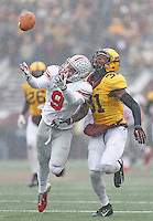 Ohio State Buckeyes wide receiver Devin Smith (9) cannot get to an overthrown catch late in the second quarter as Minnesota Golden Gophers defensive back Eric Murray (31) provides defense at TCF Bank Stadium on November 15, 2014. (Chris Russell/Dispatch Photo)