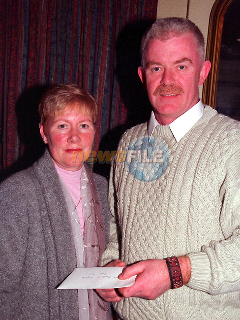 Neil Mulroy recieving a cheque on behalf of Drogheda river Rescue from Marie Russell..Picture Ciara Wilkinson Newsfile
