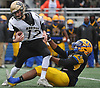 Suquan Stays #8 of Lawrence, right, sacks Wantagh quarterback Ryan McCarty #12 during the Nassau County Conference III varsity football final at Hofstra University on Saturday, Nov. 18, 2017.Lawrence won by a score of 21-10.