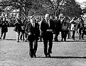 United States President Gerald R. Ford and Chancellor Helmut Schmidt of Germany stroll on the White House lawn following the arrival ceremony in Washington, DC on December 5, 1974.  Schmidt is scheduled to speak with the President about the oil problem and the economy.  Helmut Schmidt passed away on November 10, 2015 at age 96.<br /> Credit: Barry Soorenko / CNP
