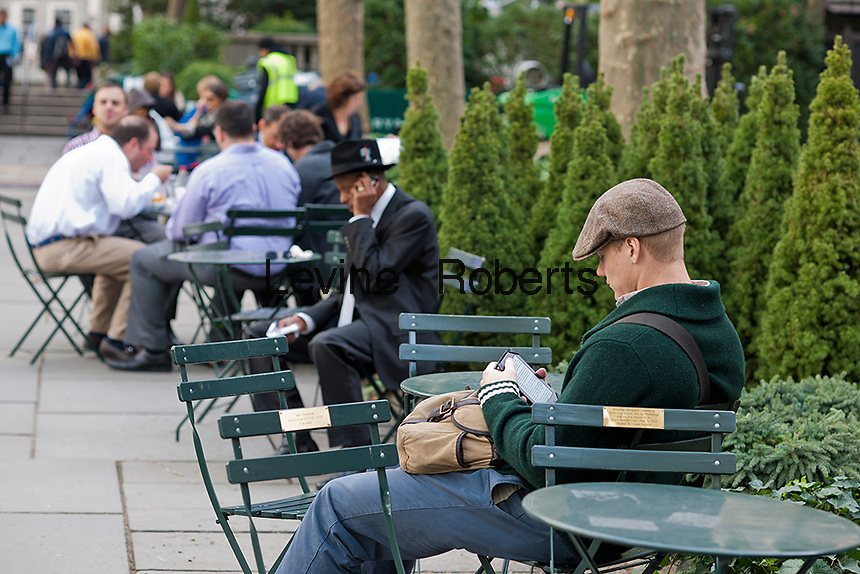A park visitor reads on his ereader in Bryant Park in New York on Wednesday, October 17, 2012 (© Richard B. Levine)