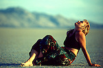 Woman relaxing on the playa, in the Black Rock Desert