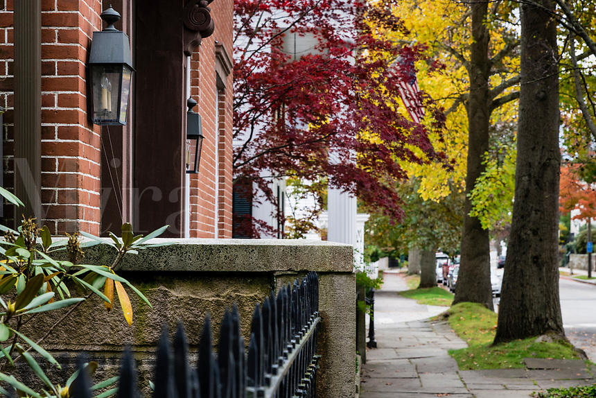 Charming homes and sidewalk in the town of Stonington, Connecticut, USA.