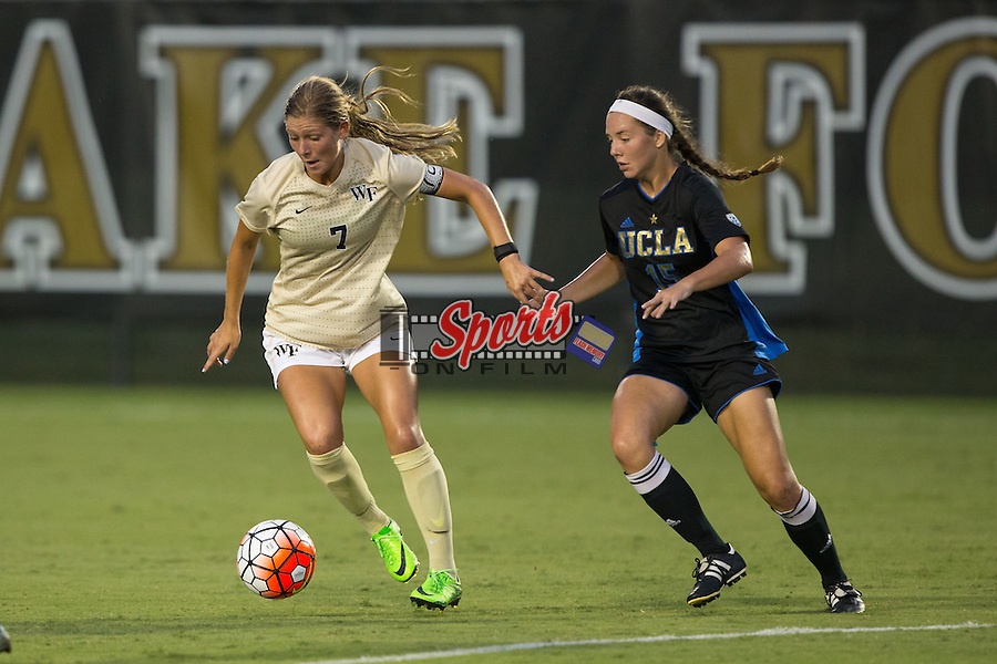 Sarah Teegarden (7) of the Wake Forest Demon Deacons keeps the ball away from MacKenzie Cerda (15) of the UCLA Bruins during first half action at Spry Soccer Stadium on September 11, 2015 in Winston-Salem, North Carolina.  The Bruins defeated the Demon Deacons 2-1.  (Brian Westerholt/Sports On Film)
