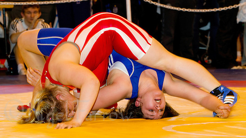 22 MAY 2010 - BIRMINGHAM, GBR -  Sarah Connolly (red) attempts to pin Chloe Spiteri (blue) at the 2010 English Senior Wrestling Championships (PHOTO (C) NIGEL FARROW)