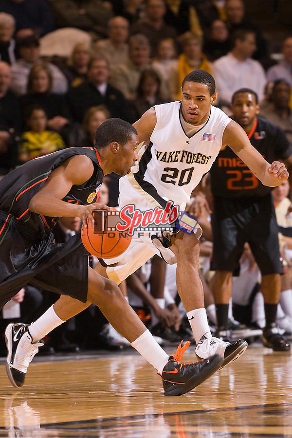 Ari Stewart #20 of the Wake Forest Demon Deacons plays defense against the Miami Hurricanes at the Lawrence Joel Veterans Memorial Coliseum February 2n Winston-Salem, NC.  The Demon Deacons defeated the Hurricanes 64-57.  Brian Westerholt / Sports On Film