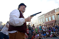 NWA Democrat-Gazette/BEN GOFF @NWABENGOFF<br /> Bob Underdown of Elm Springs acts as an armed civilian bystander on Friday Sept. 4, 2015 during a re-enactment of an 1893 bank robbery during First Friday September: Sugar Creek Days on the Bentonville square. The re-enactment was based on the June 5, 1893 robbery in which outlaw Henry Starr and five men made off with cash from the People's Bank of Bentonville after a shootout with civilians and the sheriff.