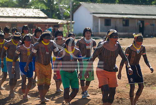 Pará State, Brazil. Aldeia Kokraimoro (Kayapo). Warriors dancing, Cacique Mudjico at the front.
