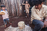 Angel Morinigo, an Mbya Guarani craftsman and musician from Andresito village near San Ignacio, Misiones, Argentina, demonstrating a traditional flute (mimby puku) and violin (rabe) he carved from the trunk of a palm tree.
