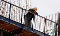 BOGOTA, COLOMBIA - MAY 12: A man works on a construction site on May 12, 2020 in Bogota, Colombia. Colombian President Ivan Duque extended COVID-19 lockdown from May 11 to 25, including some exceptions by industry and territory. (Photo by VIEW press/Getty Images)