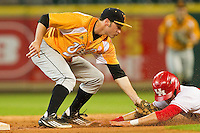 Will Maddox #1 of the Tennessee Volunteers puts the tag on Jacob Lueneburg #42 of the Houston Cougars as he tries to steal second base at Minute Maid Park on March 2, 2012 in Houston, Texas.  The Cougars defeated the Volunteers 7-4.  (Brian Westerholt/Four Seam Images)