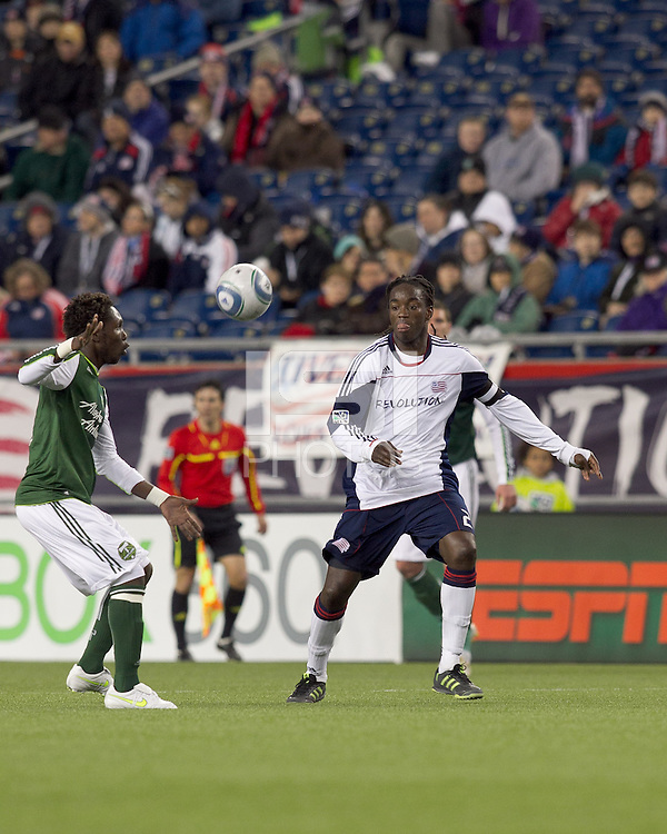 New England Revolution midfielder Shalrie Joseph (21) at midfield. In a Major League Soccer (MLS) match, the New England Revolution tied the Portland Timbers, 1-1, at Gillette Stadium on April 2, 2011.