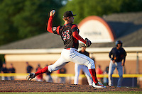 Batavia Muckdogs relief pitcher Justin Langley (55) delivers a pitch during a game against the State College Spikes on June 24, 2016 at Dwyer Stadium in Batavia, New York.  State College defeated Batavia 10-3.  (Mike Janes/Four Seam Images)