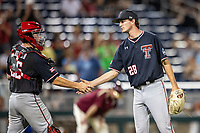 Texas Tech Red Raiders pitcher Tanner Floyd (28) is greeted by catcher Braxton Fulford (26) after closing out Game 9 of the NCAA College World Series against the Florida State Seminoles on June 19, 2019 at TD Ameritrade Park in Omaha, Nebraska. Texas Tech defeated Florida State State 4-1. (Andrew Woolley/Four Seam Images)
