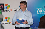Microsoft Chairman and Chief Software Architect Bill Gates signs a copy of Windows XP at a launch  celebration at CompUSA October 24, 2001 in New York. Windows XP is the latest operating system from  Microsoft.