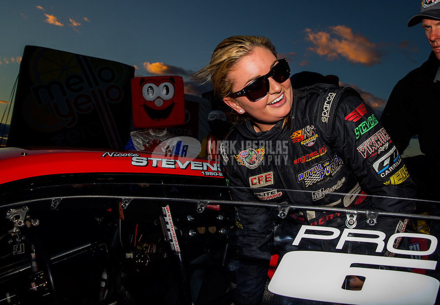 Nov 2, 2014; Las Vegas, NV, USA; NHRA pro stock driver Erica Enders-Stevens celebrates after winning the Toyota Nationals at The Strip at Las Vegas Motor Speedway. Mandatory Credit: Mark J. Rebilas-USA TODAY Sports