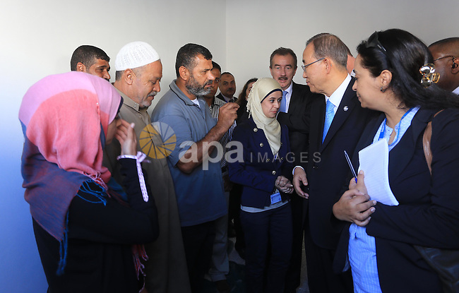 United Nations (UN) Secretary General Ban Ki-moon meets with Palestinian fishermen at the UN fishermen project, in Gaza City on October 14, 2014. The UN chief's visit to the Gaza Strip came a day after a Cairo conference at which international donors pledged USD 5.4 billion (4.3 billion euros) to rebuild the war-ravaged Gaza Strip. Photo by Mohammed Asad