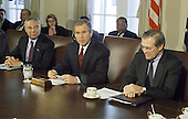 United States President George W. Bush meets with his new cabinet in the Cabinet Room of the White House in Washington, D.C. on January 31, 2001.  From left to right; U.S. Secretary of State Colin Powell, President Bush, U.S. Secretary of Defense Donald Rumsfeld.<br /> Credit: Mark Wilson / Pool via CNP