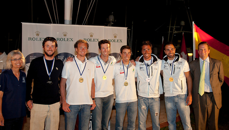 (L to R).2nd: NED1, Fleet: 470-Men, Crew: sven coster, coster kalle, Country: NED.1st: AUS 11, Fleet: 470-Men, Crew: Mathew Belcher, Malcolm Page, Country: AUS.3rd: GRE 1, Fleet: 470-Men, Crew: Panagiotis Mantis, PAVLOS KAGIALIS, Country: GRE
