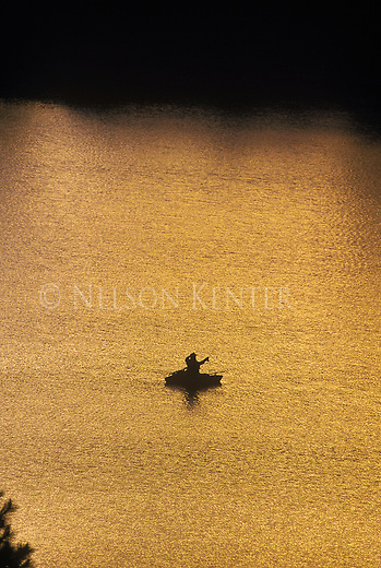 A fly fisherman in a float tube on Harpers Lake in Montana