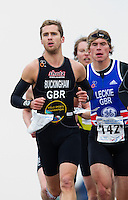 27 MAR 2011 - LOUGHBOROUGH, GBR - Mark Buckingham leads Todd Leckie (right) during the first run of the British Elite Mens Duathlon Championships (PHOTO (C) NIGEL FARROW)