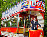 © Joel Goodman - 07973 332324 . 6 August 2013 . Heaton Park , Manchester , UK . SIR HOWARD BERNSTEIN , Chief Executive of Manchester City Council , poses on a historical tram after laying a foundation stone to commemorate the commencement of work on a new depot to house the growing collection of trams in the care of the Manchester Heaton Park Tramway Society . Photo credit : Joel Goodman